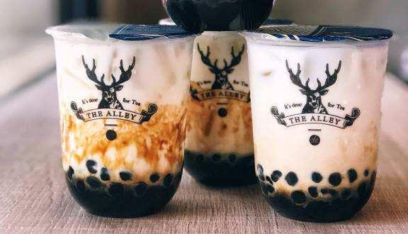thiết kế logo ly trà sữa